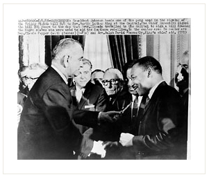 Martin Luther King receiving one of the pens used by President Lyndon B. Johnson to sign the Voting Rights Act, August 6, 1965.